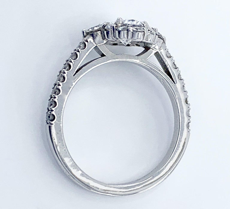 GIA Certified 0.80 Carat Oval Diamond Engagement Ring in White Gold Halo Setting For Sale 4