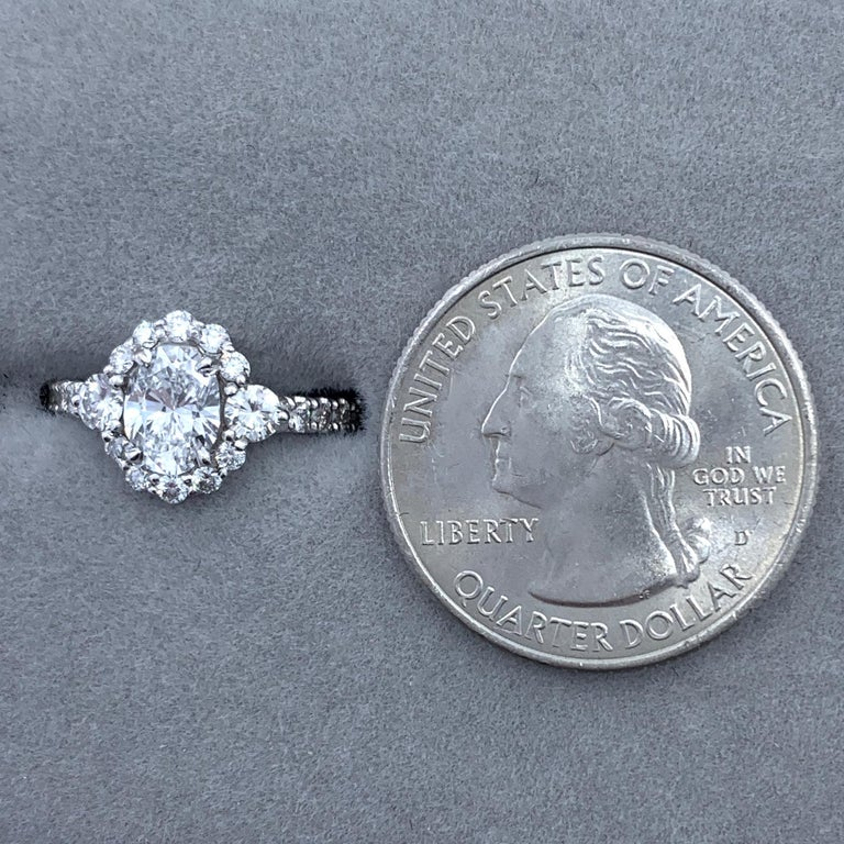 GIA Certified 0.80 Carat Oval Diamond Engagement Ring in White Gold Halo Setting For Sale 5