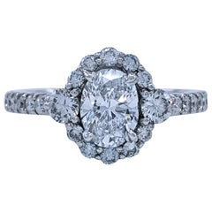0.80 Carat Oval Diamond Engagement Ring in White Gold Halo Setting