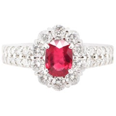 0.81 Carat Ruby and Diamond Halo Ring Set in Platinum