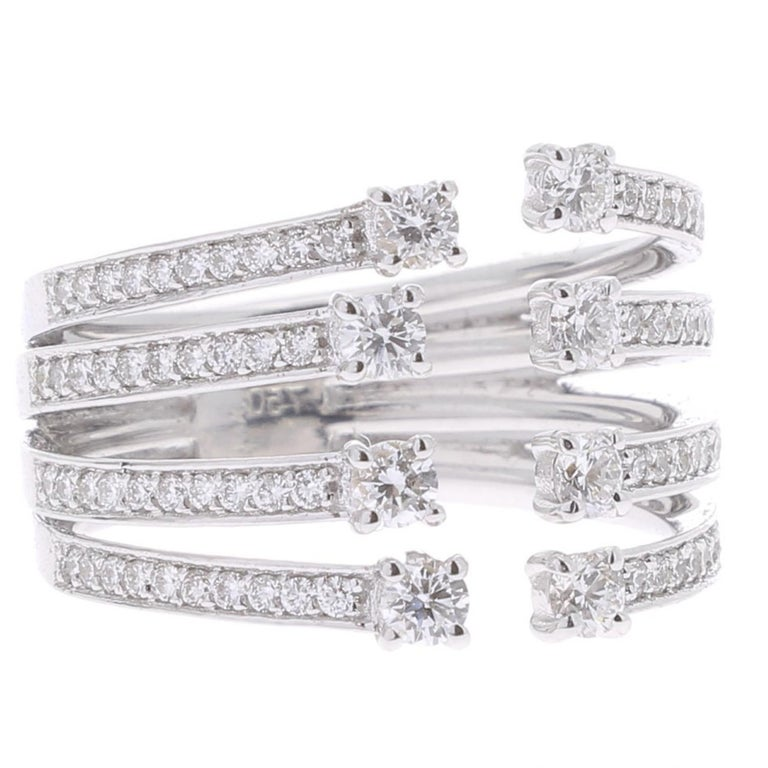 The infinity ring is a unique jewelry set with 4 row of Round Diamonds whose ends are adorned with Diamonds. The Cocktail ring weight 0.82 Carat with GVS Diamonds. The Ring is in 18K White Gold. The ring size is 6 ½ US and can be size.