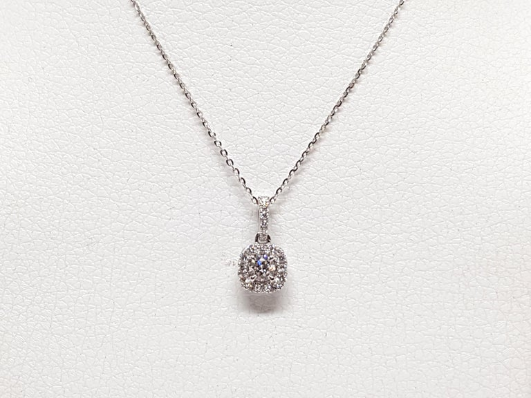 Gold: 18K White Gold.  Weight: 1.87 gr.  Center Diamonds 0.25ct. Colour: F Clarity: VS1  Accent Diamond: 0.58ct. Colour: F Clarity: VS1  Length Pendant: 1.40 cm.  Width Pendant: 0.71 cm.  Length chain: choose between 40, 42, 45cm.  All our jewellery