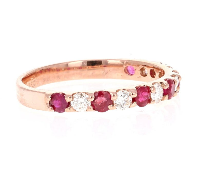 Diamond and Ruby Rose Gold Band!  Elegant and classy 0.86 Carat Diamond and Ruby band that is sure to be a great addition to your accessory collection!   There are 7 Round Cut Diamonds that weigh 0.36 carats and 7 Round Cut Rubies that weigh 0.50