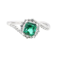 0.86 Carat, Natural, Colombian Emerald and Diamond Ring Set in Platinum