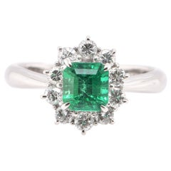 0.86 Carat Natural Emerald and Diamond Halo Ring Set in Platinum