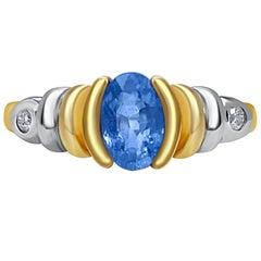 0.86 Carat Oval Cut Tanzanite and Diamond 14K Yellow Gold Engagement Ring