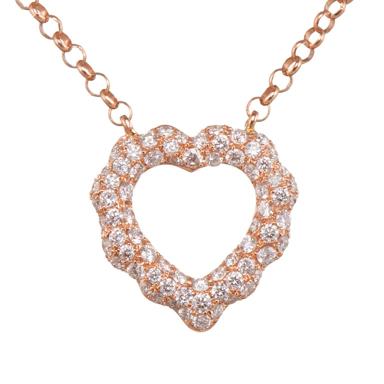 Cast in the shape of the heart, Butani's pendant necklace is handcrafted from 18-karat rose gold and is encrusted with 0.87 carats of sparkling pavé diamonds.  Wear it solo or layered with other pieces.  Chain length 16 inches.  Composition: 18K