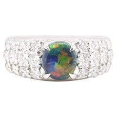 0.87 Carat Natural Black Opal and Diamond Ring Set in Platinum