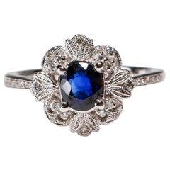 0.87 Carat blue Sapphire 0.13 Carat white Diamond 18 Karat Gold Floral Halo Ring