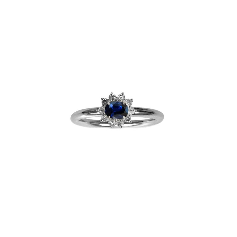 This luxurious platinum ring features deconstructed elements from repurposed vintage Sapphire stone settings in the center. These rare and classic settings were made by highly skilled craftsmen and includes brilliant cut diamonds. This is a
