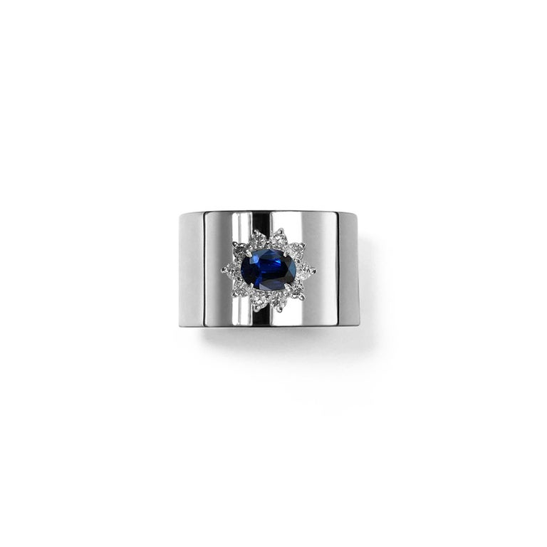 This luxurious wide-band platinum ring features deconstructed elements from repurposed vintage Sapphire stone settings in the center. These rare and classic settings were made by highly skilled craftsmen and includes brilliant cut diamonds. This is