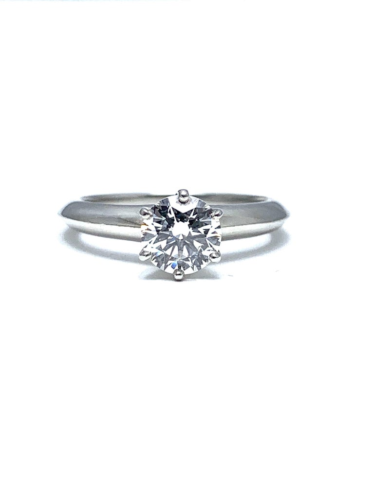A stunning Tiffany & Co. round brilliant diamond solitaire platinum ring.  the diamond is set in a six prong head on a knife edge shank.  The diamond is 0.89cts, E color, VS1 clarity.  