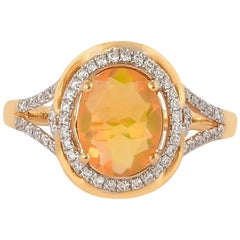 0.9 Carat Ethiopian Opal with Diamond Ring in 18 Karat Yellow Gold