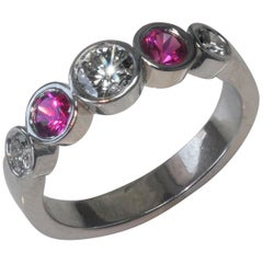 0.90 Carat Approximate Pink Sapphire and Diamond Bezel Set Band, Ben Dannie