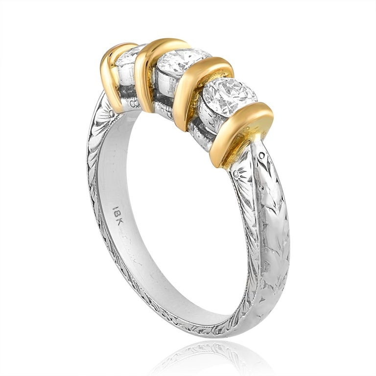 Carved Filigree Leaf & Flower Design. The ring is 18K White & Yellow Gold. The 3 Diamonds are Round Brilliant Cut. All 3 diamonds total 0.90 Carats F VS. The ring weighs 7.5 grams. The ring is a size 6.25, sizable.