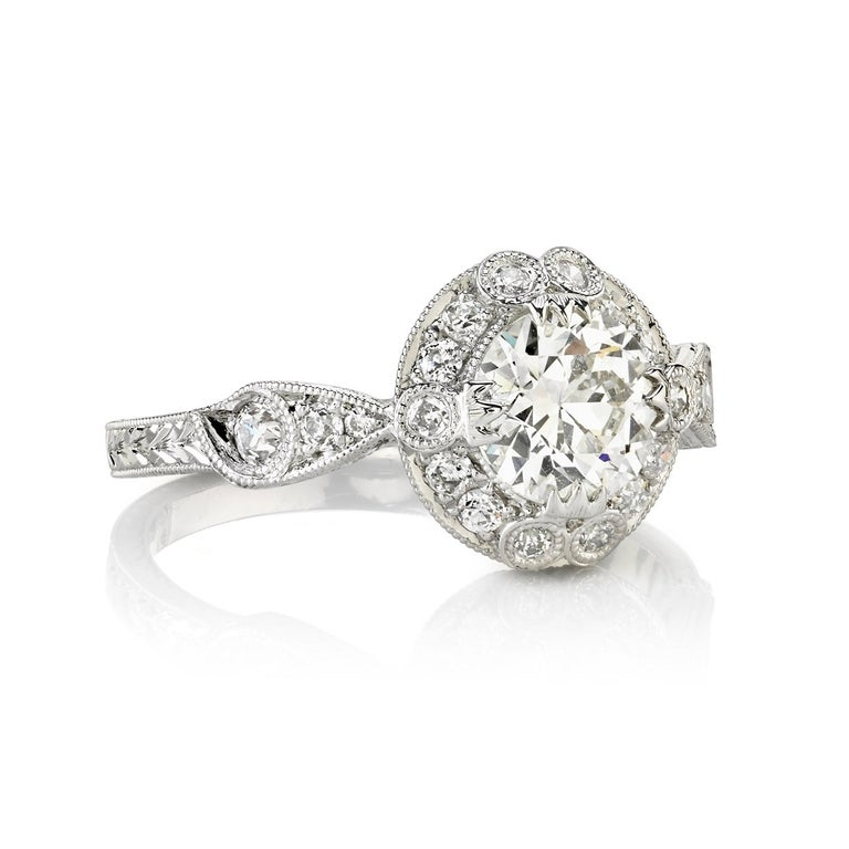 0.90ct G/VS1 EGL certified old European cut diamond with 0.31 ctw old European cut accent diamonds set in a handcrafted platinum mounting.   Ring is a size 6 and can be sized to fit.