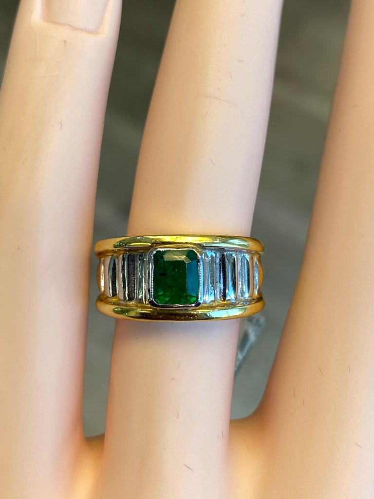 Lovely emerald ring. 0.91 carat emerald cut emerald. 18k yellow and white gold, bezel set. Accommodated with an up to date appraisal by a GIA G.G., please contact us with any questions. Thank you.  Item Number  R3804  1 Emerald Cut Emerald =