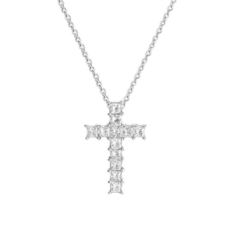 18-karat white gold necklace features a cross pendant accented by 0.92 carats of princess cut diamonds.  Chain length 16 inches.  Pendant height 2cm, pendant width 1.2cm.    Composition: 18K White Gold 12 Princess Cut Diamonds: 0.92 carats Diamond