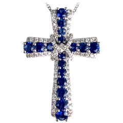 0.92 Carat Vivid Blue Sapphire and Diamond Embellished Cross Pendant