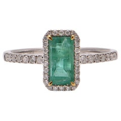 0.93 Carat Emerald and Diamond Ring in 18 Carat White Gold