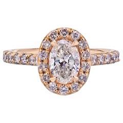 0.93 Carat Oval Diamond G/SI2 EGLA Halo Engagement Ring
