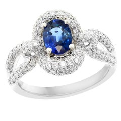 0.94 Oval Cut Blue Sapphire and Diamond 18 K white Gold Engagement Ring