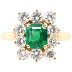 0.95 Carat Emerald and Diamond Engagement Ring Set in 18 Karat Gold