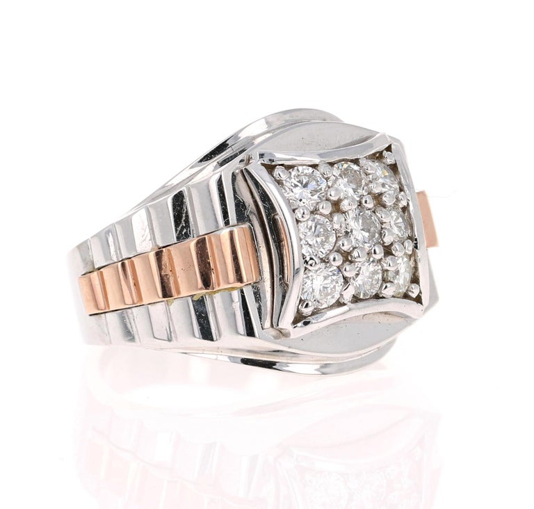 We have a Men's Collection of Fine Jewelry!  Beautiful, Bold, Masculine and Simple Men's Wedding Rings/Bands.   This Men's Ring has 9 Round Cut Diamonds that weighs 0.95 Carats.  The Clarity and Color of the Diamonds is SI-F.  It is crafted in 14