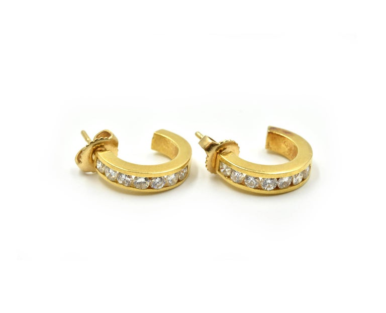 Designer: custom design Material: 18k yellow gold Diamonds: 14 round brilliant cuts = 0.98 carat total weight Fastenings: friction backs Dimensions: each huggie style hoop earring measures a 1/2-inch in length and 1/8-inches in width  Weight: 4.70