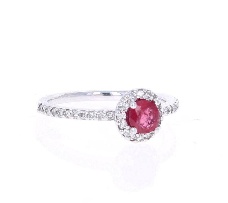 This elegant and dainty Ruby Diamond Ring can be a modern Engagement/Promise ring. It has a Round Cut Ruby that is 0.64 carats with a flow of 38 Round Cut Diamonds weighing 0.35 carats.  The total carat weight of the ring is 0.99 carats. It is set