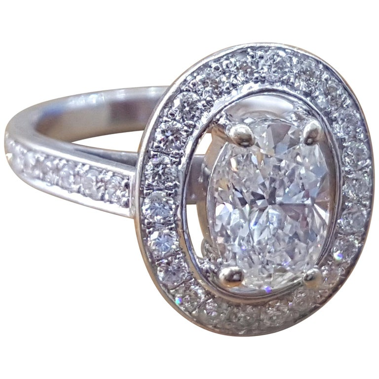 1 1/2 Carat 14 Karat White Gold Oval Engagement Ring, Oval Halo Ring For Sale