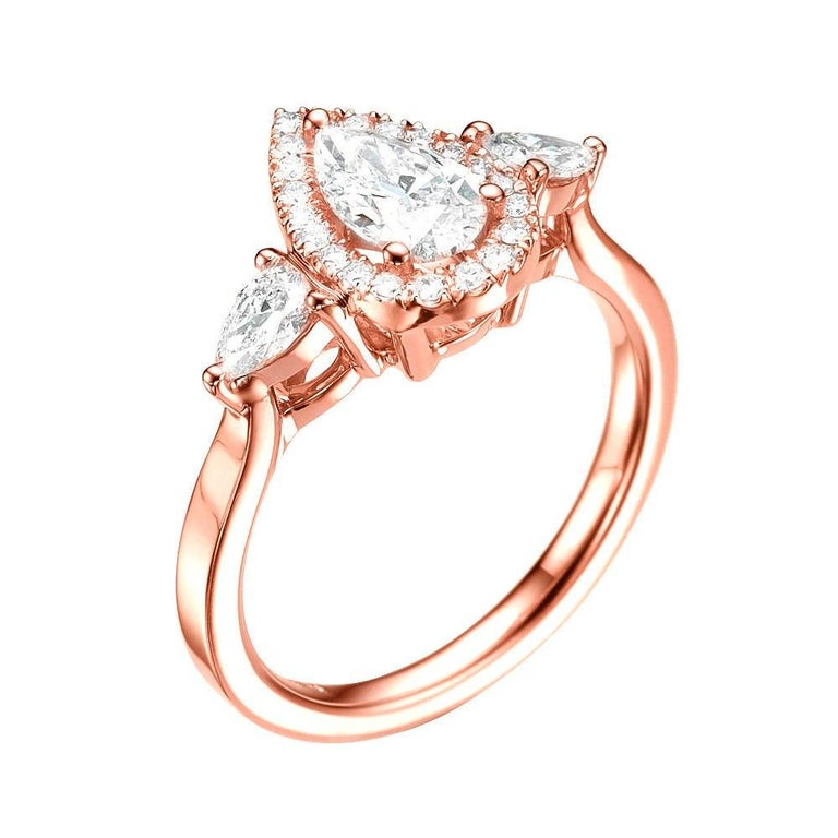 A beautiful pear shaped diamond engagement ring made of 14K Rose Gold set with a pear cut diamond of 0.70ct (can be set with any stone size) accented by white pear and round diamonds. The center diamond of this classic pear halo ring is of Excellent