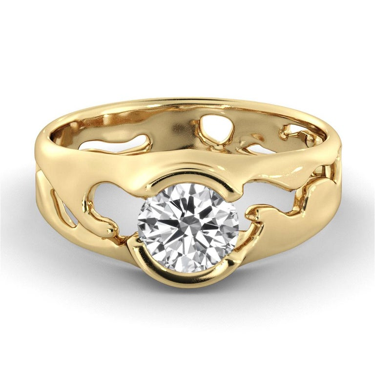Offered here is a unique designer setting GIA certified diamond engagement ring. Ring features a 1.5 carat round cut 100% eye clean natural diamond of F-G color and VS2-SI1 clarity. Set in a sleek, 18K yellow gold, solitaire ring with a bezel