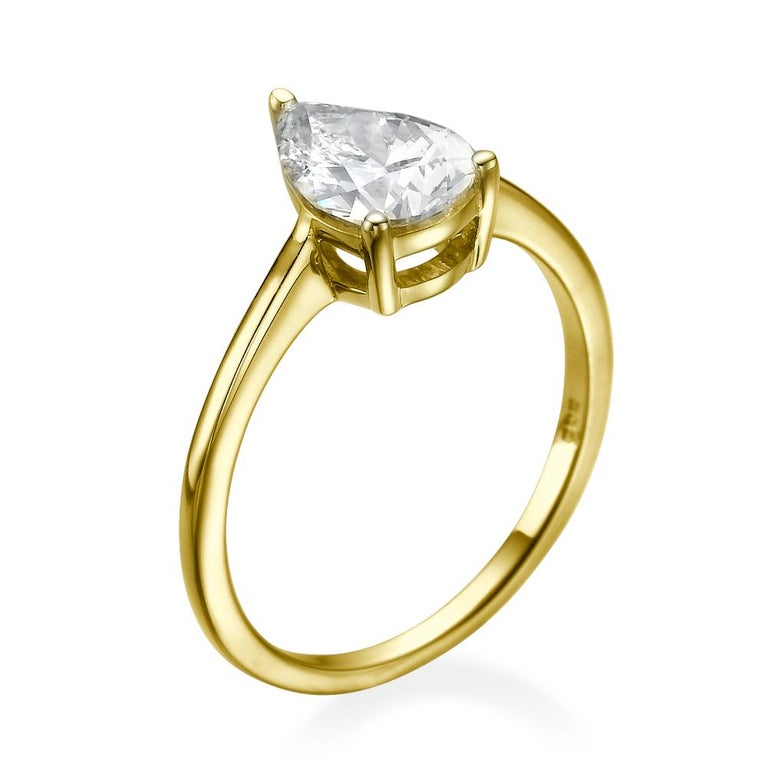 This breathtaking two-tone gold ring features a solitaire GIA certified diamond. Center is of 1.5 carat pear cut 100% eye clean natural diamond of F-G color and VS2-SI1 clarity. Set in a sleek, 18K yellow gold, solitaire ring with a 3-prong setting,