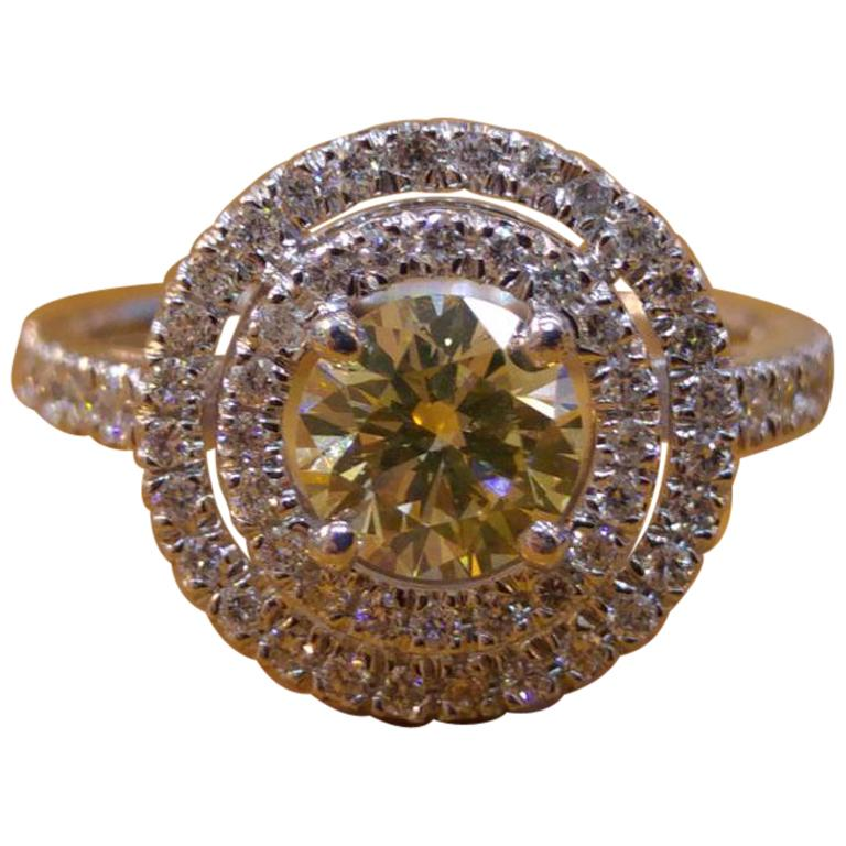 1 1/4 14 Karat White Gold Fancy Yellow Round Diamond Double Halo Engagement Ring For Sale