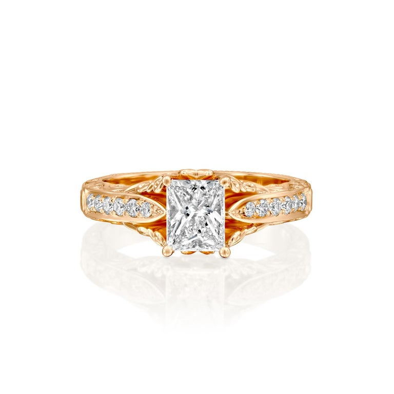 This breathtaking Victorian style ring features a solitaire GIA certified diamond. Ring features a 1 carat radiant cut 100% eye clean natural diamond of F-G color and VS2-SI1 clarity and it is accented by diamonds of approx. 0.25 total carat weight.