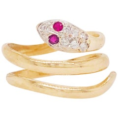 1/10 Carat '0.10 Carat' Diamond & Ruby Snake Wrap Ring in 18 Kt Gold, circa 1955