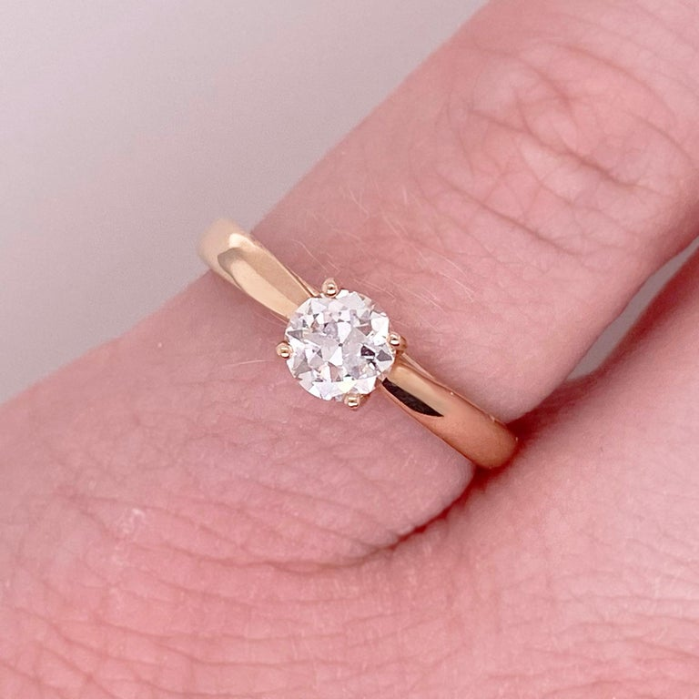 Gorgeous round old European cut diamond solitaire engagement ring! This gorgeous center diamond is set in four polished prongs. The 14 karat rose gold engagement ring is the perfect compliment to this stunning round diamond. Very stunning and