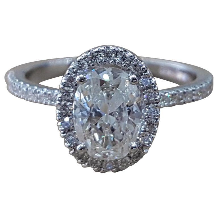 1 3/4 Carat 14 Karat White Gold Oval Diamond Ring, Diamond Halo Art Ring For Sale