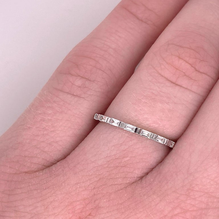 This stunningly beautiful 14K white gold band dripping with baguette diamonds provides a look that is very classic and modern at the same time! This ring is very fashionable and can add a touch of style to any outfit, yet it is also classy enough to