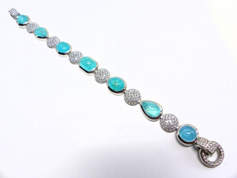 Thomas Leyser is renowned for his contemporary jewellery designs utilizing fine gemstones.  This braclet in 950/Platinum with 61,2gr. is set with 7 top quality, matching Paraiba Cabouchons with 27,07cts., in magnificient intensiv blue/green (so