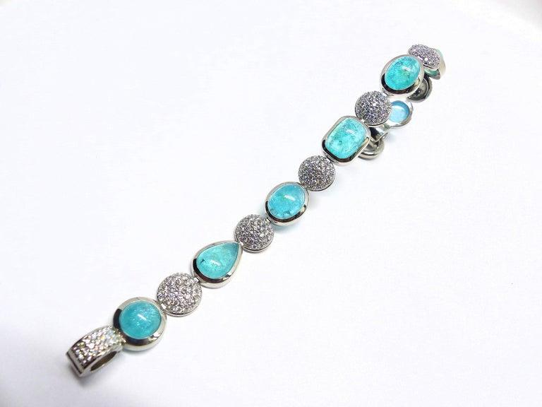 Contemporary 7 Paraiba Tourmaline Cabochons and Diamond Platinum Bracelet For Sale