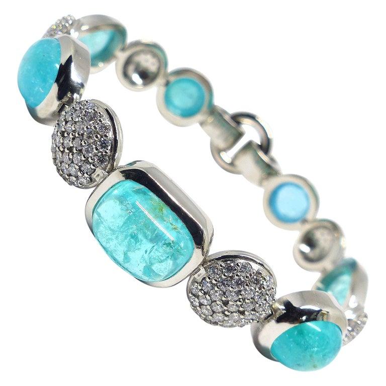 7 Paraiba Tourmaline Cabochons and Diamond Platinum Bracelet For Sale