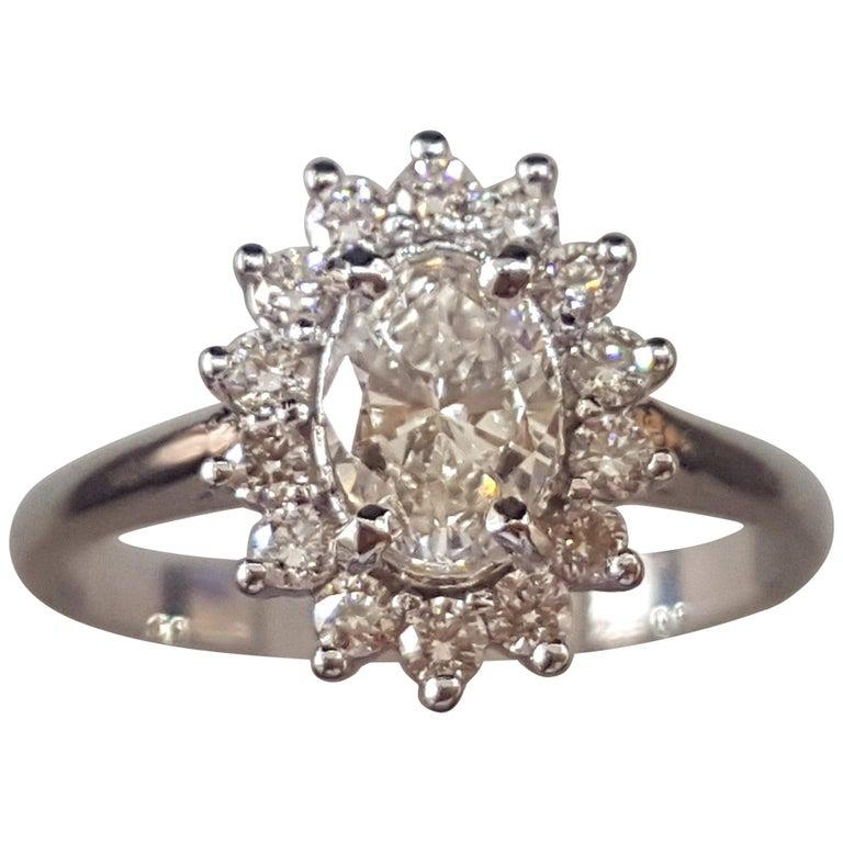 1 Carat 14 Karat White Gold Oval Diamond Engagement Ring, Halo Ring For Sale