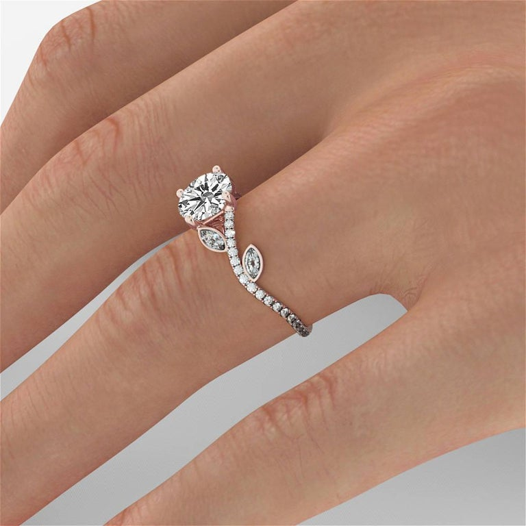 This 14k rose gold flower diamonds ring is perfect for anyone looking for a unique engagement ring.  The 0.50cttw pave set marquise and round white diamonds are carefully set aside the beautiful round 1/2 carat diamond, creating an eye catching