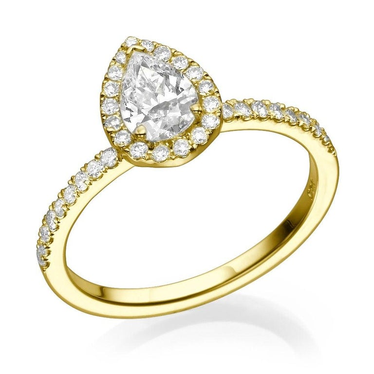 1 Carat Pear Shaped Engagement Ring, Pear Diamond Ring, Pear Halo Ring, Pear Engagement Ring, Pear Diamond Halo Ring Yellow Gold    Main Stone Name: 0.70ct Natural Diamond  Main Stone Clarity: VS2  Main Stone Color: F  Main Stone Shape: Pear  Main