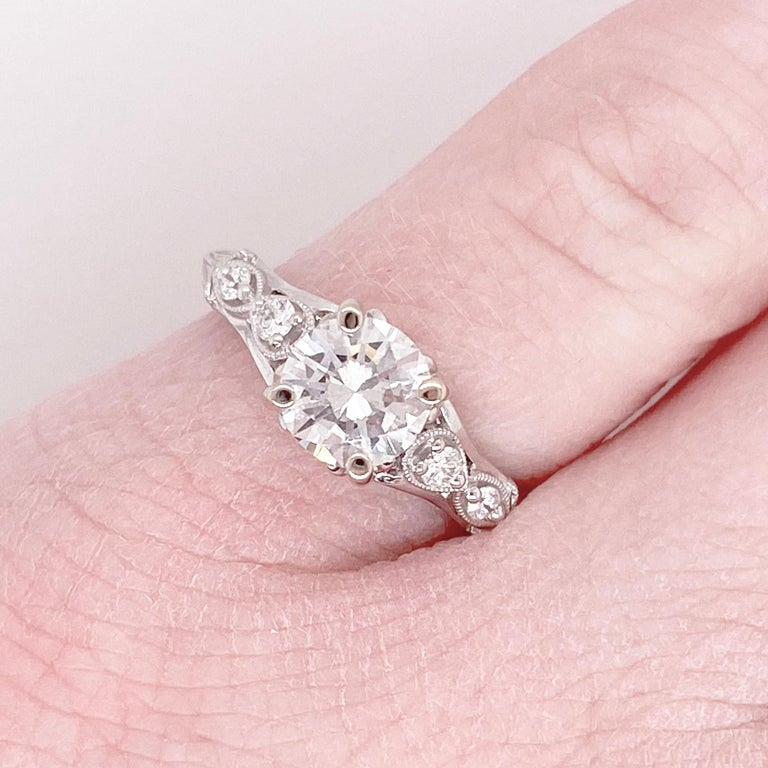 This stunning 14k white gold ring dripping with diamonds is sure to take your breath away! This ring provides a look that is very modern yet classic. This ring is very fashionable and can add a touch of style to any outfit, yet it is also classy
