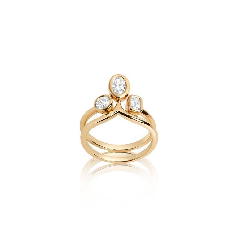This stackable ring set consists of two rings that fit nestled perfectly together. It can be worn together or separately.   Inspired by seeing the cross-section view of life, as if slicing a tree to see its underlying structure and raw beauty, Hi