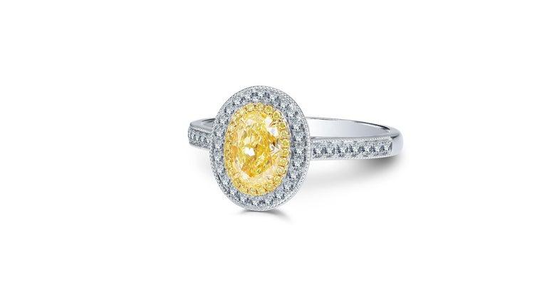 Contemporary 1 Carat Fancy Yellow Diamond Ring 18 Karat White Gold For Sale