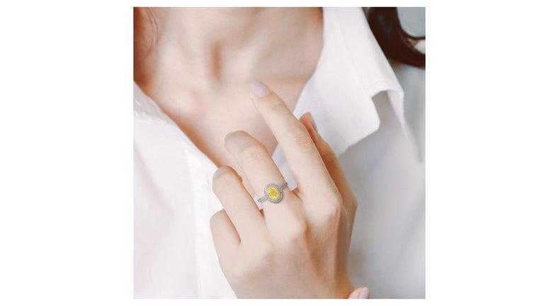 Oval Cut 1 Carat Fancy Yellow Diamond Ring 18 Karat White Gold For Sale